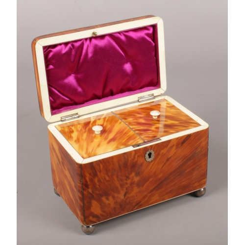 7 - A Victorian tortoise shell tea caddy with a hinged lid and two sections to the interior. 14cm x 18cm...
