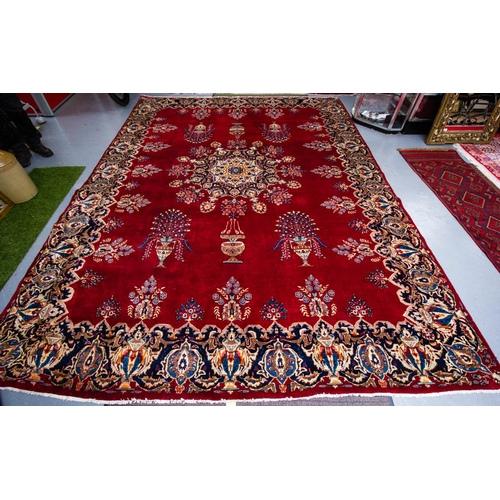 OLD PERSIAN KASHMAR RUG. CLARET GROUND WITH CREAM MEDALLION . 392 X 298CM