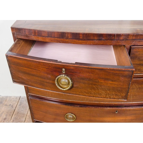 12 - A Georgian mahogany cross banded bow front chest, with 2 short over 3 long graduated drawers, restin...