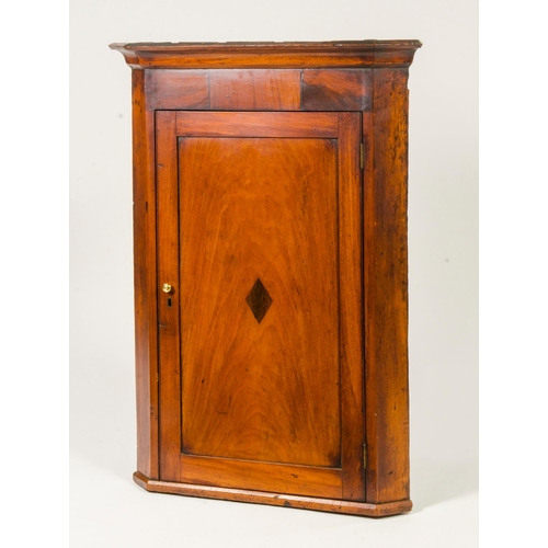 15 - Antique mahogany and inlaid corner cupboard, fitted with shelves, brass handle and cornice, width 72...
