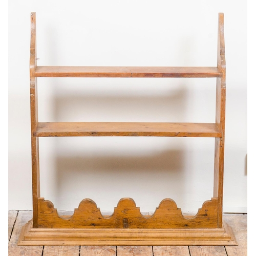 16 - A set of pine kitchen wall hanging shelves,  with a pierced fretted top, width 92cm...