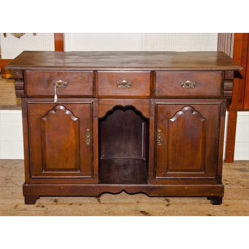 21 - An Edwardian Art Nouveau design side board, stained as oak, fitted 3 drawers 2 cupboards and central...