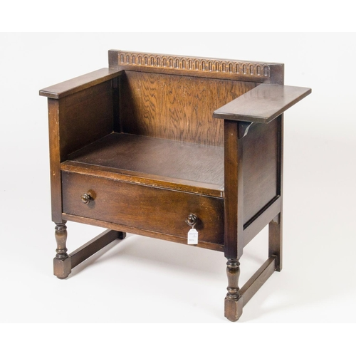 22 - Reproduction oak telephone seat, Jacobean taste, resting on turned legs, width 74.5cm...