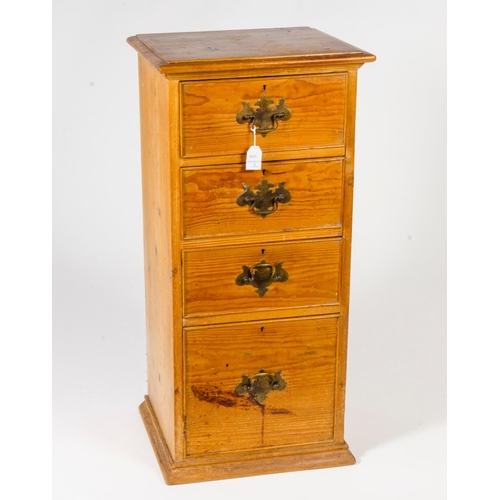 24 - A narrow pitch pine chest, 4 graduated drawers, fitted brass handles, width 44cm...