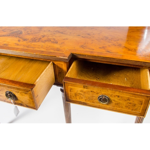 25 - A reproduction serving side board, yew wood veneered, with cross banded decoration, fitted 3 drawers...