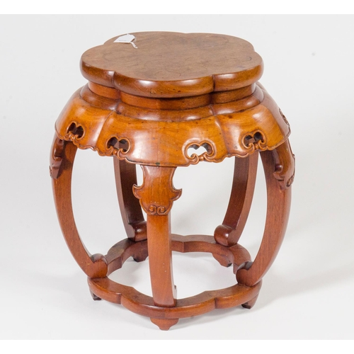 28 - A Chinese hard wood jardiniere stand, decorated with batwing carving shaped freize under tier and ro...