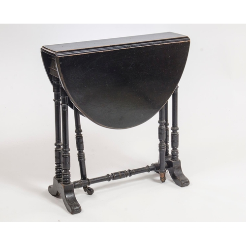 29 - A Victorian Aesthetic period ebonized drop flap sutherland table, resting on turned legs, width 54.5...