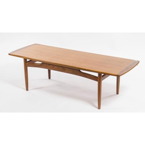30 - A 1960s teak long John coffee table, resting on turned legs, width 136.5cm...