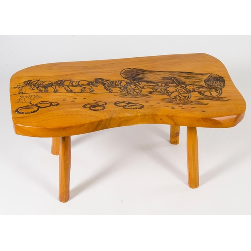 32 - Modern carved chestnut coffee table, the scene carved with wagons, loggers and horses, width 97cm...