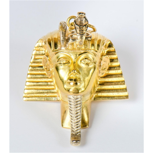 329 - An unusual 1970s 750 gold study Tutankhamun head with ribbed and engraved decoration, 17 grams...