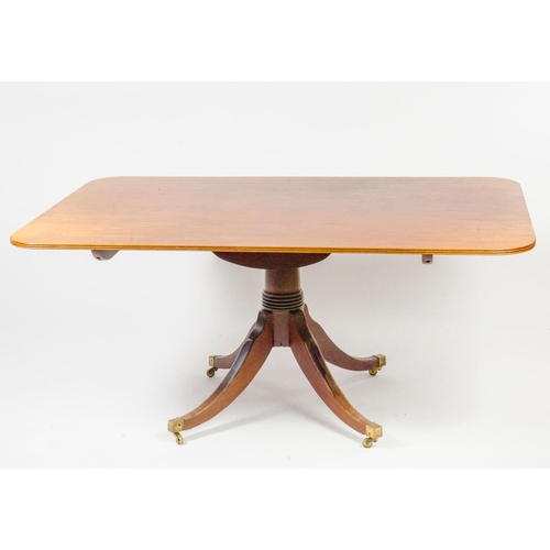 33 - A Regency mahogany breakfast table, rectangular shaped with top fold over, resting on tripod mahogan...