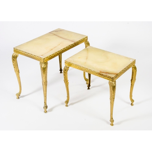 34 - 2 graduated onyx topped Italian design coffee tables, with gilt metal legs, width 54cm...