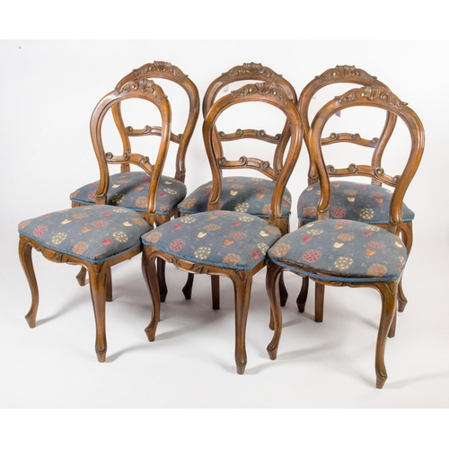 36 - A set of 6 Victorian design hoop and carved back dining chairs, with carved fronts resting on Spanis...