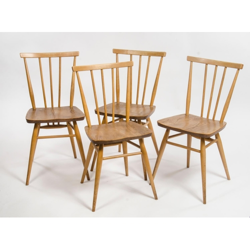 37 - A set of 4 Ercol turned wooden back dining chairs, resting on swept out legs...