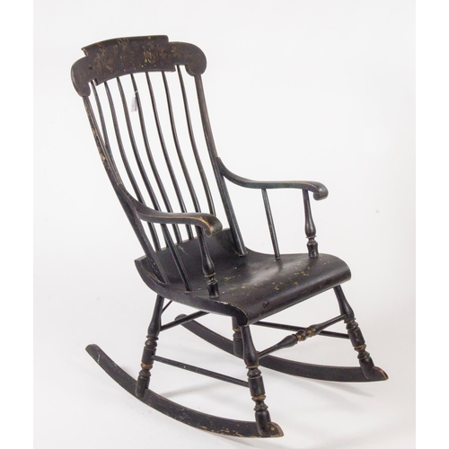 39 - American wooden framed rocking arm chair, black paint effect and painted decoration...
