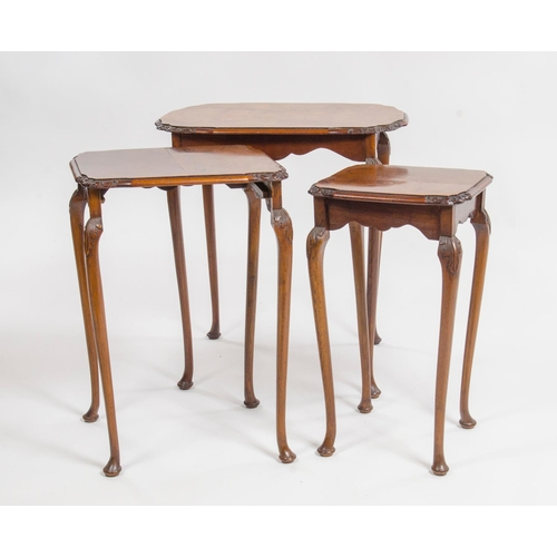 4 - Nest of 3 tables, in graduated veneered burr walnut, resting on carved legs, width 53.5cm...