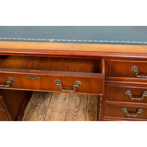 5 - Reproduction mahogany pedestal desk, fitted with 3 graduated drawers over 6 short drawers, width 121...