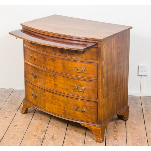 7 - Reproduction mahogany bachelors chest, 4 graduated draws fitted with slide, resting on swept out fee...