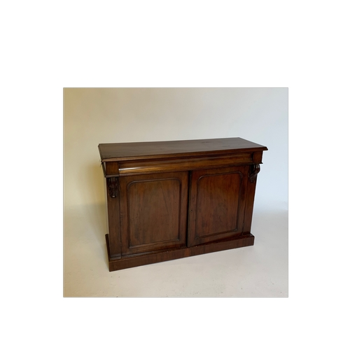 23 - A Victorian mahogany chiffonier base, fitted 2 doors, single draw and carved ends, width 123cm...