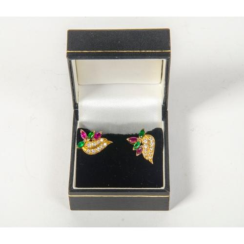 89 - A pair of diamond and ruby garnet earrings. 5.0 grams....