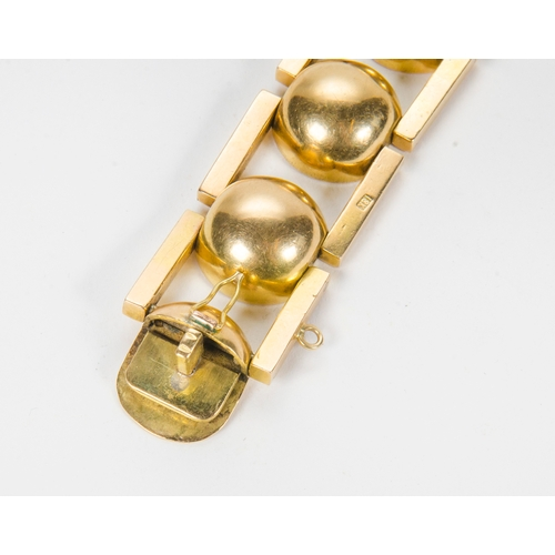 99 - An 18 Carat Gold Ball and Bar Bracelet, modernist design, marked 18K, possibly after a design to Nau...