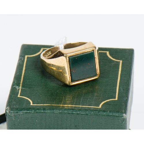 102 - A Gentleman's 9 carat gold signet ring set with a blood stone. 6.5 grams. Size Q....
