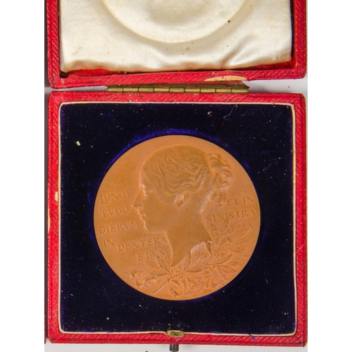 146 - A Queen Victoria Jubilee Bronze Medal, 1837-1897, depicting a young Queen Victoria, young head/veile...