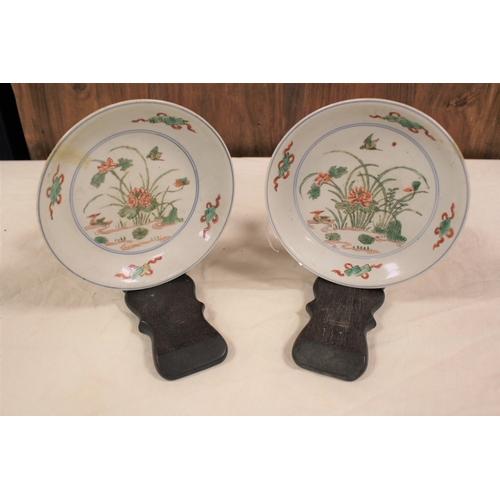 153 - A pair of Chinese Cheng Lung designed low saucer dishes decorated with reeds and birds in a pond set...