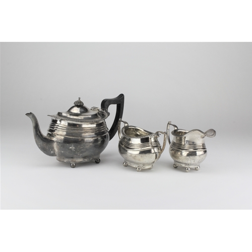 1 - Three piece silver tea set, Georgian design, with gadroon boarder, and ebony handle.  786 grams....