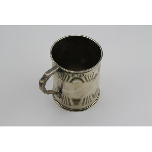 4 - A Victorian silver reeded child's mug. 158 grams....