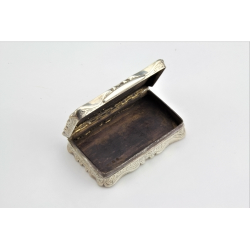 5 - A Victorian silver engraved snuff box, with a vacant cartouche, hallmarked for Birmingham. 99 grams....
