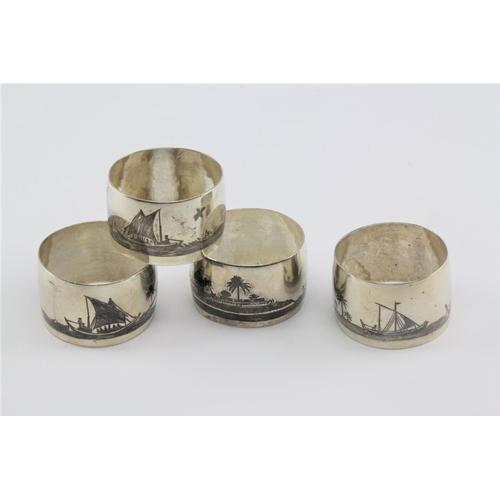 7 - A set of four Egyptian Niello SCWM napkin rings....