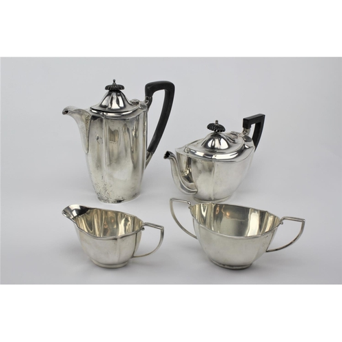 9 - A four piece silver fluted pattern tea set, makers mark BB & Co, W in a shield. 1,701 grams....