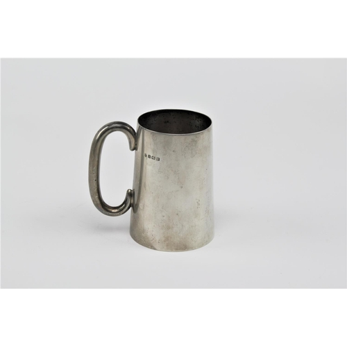 12 - A silver straight sided pint beer mug, with hollow handle, Birmingham R, by Nathan and Hays. 359 gra...