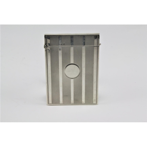 33 - A engine turned silver card case, Birmingham W. 81 grams....