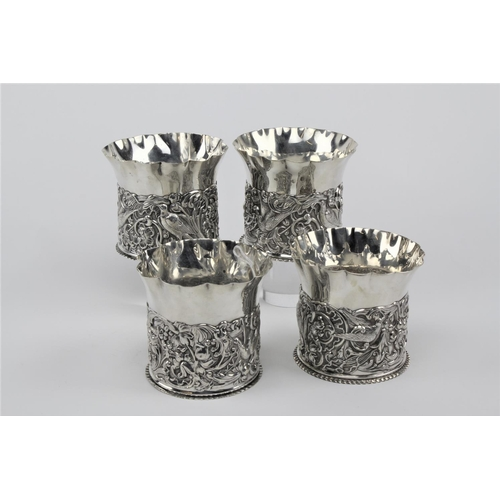 36 - A set of four silver embossed fern pots, bird and floral design, marked London Q, by William Comyns....