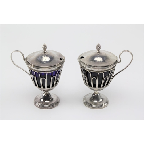 37 - A pair of French silver mustard pots, wire work, with blue glass liners, crested bird serpent and ro...