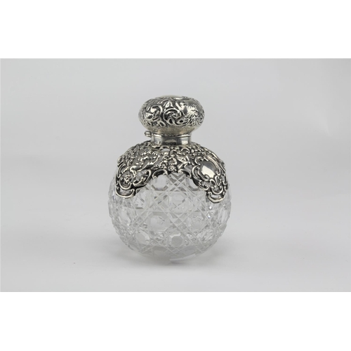 39 - A Victorian hobnail cut glass scent bottle, silver mounted, cherub decorated, Chester C....
