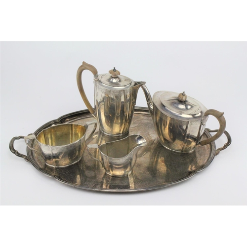 46 - An Edwardian four piece silver tea set, with engraved floral boarders, wooden handles and mounts, ma...