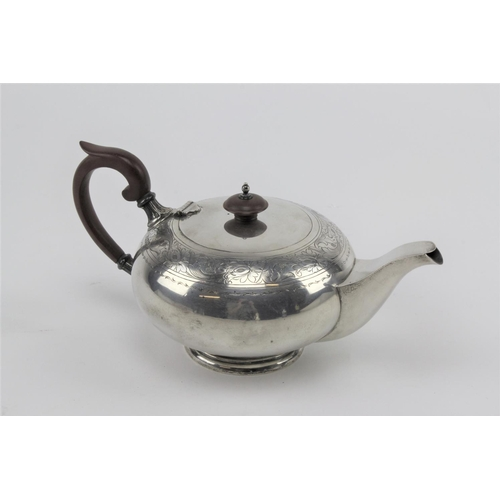 49 - A solid silver teapot, by Walker & Hall of Sheffield. Total weight 688.3 grams....