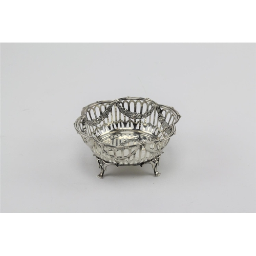 53 - 1910 solid silver basket, Birmingham. 133 grams. 13cms across & 6cms High....