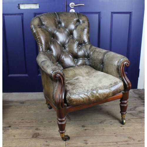 414 - A leather Victorian library chair, in green leather, and casters....
