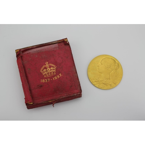 635 - A Victoria 1837-1897 gold medal, depicting the young head Victoria with verse, and the veiled head w...