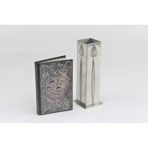 20 - A silver fronted address book, decorated with cupids, along with a Mackintosh vase....