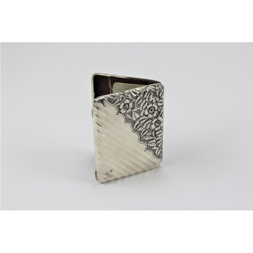 34 - A Victorian silver note case, fluted and floral patterned, with ivory pencil board, Birmingham D....
