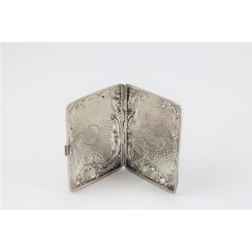 35 - A Victorian embossed silver case, Birmingham, marks rubbed. 86 grams....