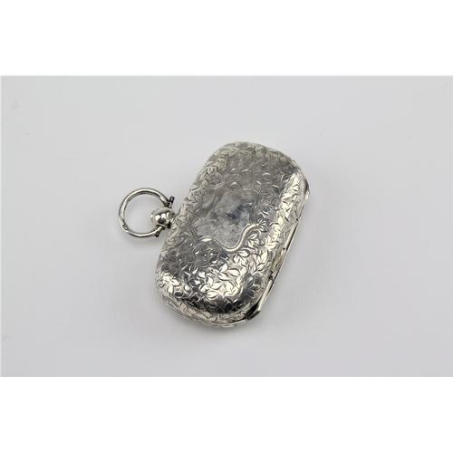 41 - A silver and engraved half sovereign case. 27 grams....