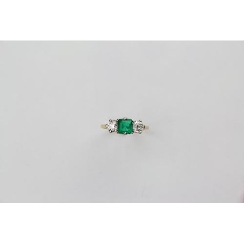 92 - 18ct Gold Emerald & Diamond Three Stone Ring. Emerald Size: 5.7mm x 5.9mm x 3.4mm. Emerald Weight 0....