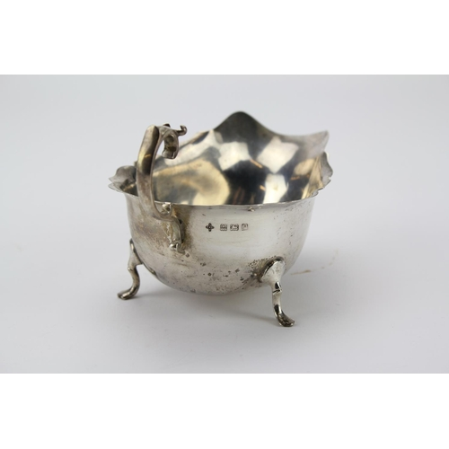 35 - A Silver styled Chippendale sauce boat with pad feet. Total weight 2.99oz....