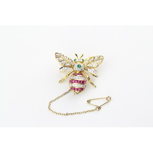 159 - A 1920's Bee brooch, mounted with various Diamonds, Ruby's and Emeralds with moving wings and safety...